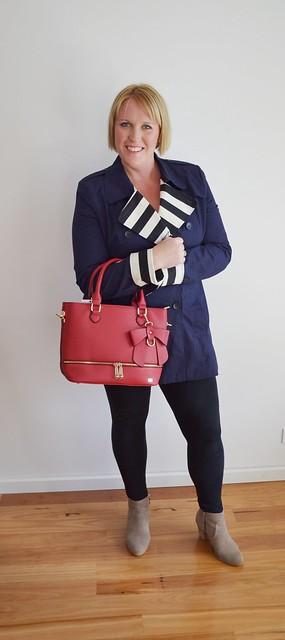 Kristy holding Sash & Belle Carmen handbag