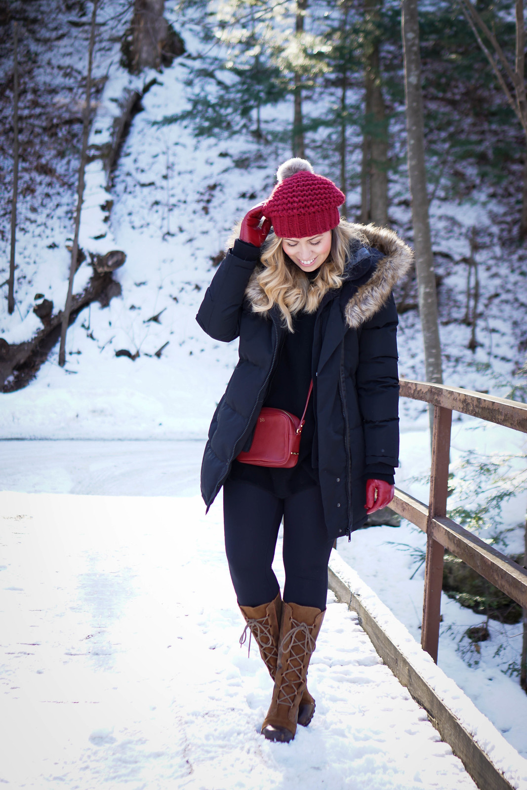 Must Have Winter Boots Black & Red Winter Snow Outfit | Noize Down Parka Sorel Lace Up Boots Black Leggings