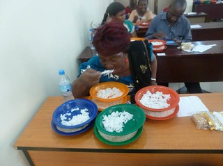 Taste testing: Participants tasted cooked samples of each of the rice varieties during the experimental auctions (Photo credit: AfricaRice/ Gaudiose Mujawamariya)