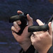 Profile view of hands of Palmer Luckey (Founder, Oculus) holding Oculus Touch prototype Half Moon at Step into the Rift