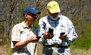Dave Dickson, left, instructs a participant in CLEAR's course on smartphone GPS mapping.