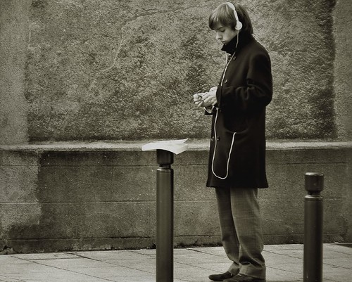 Rolling a cigarette I think... | by *Louise**