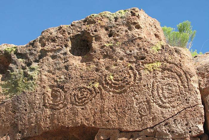 Rock art (petroglyphs) at Tsirege Pueblo. Petroglyphs are images that have been pecked, incised, or abraded into tuff cliff faces or boulders.