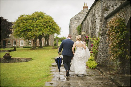 Well Groomed Groom Suit and Dress and Umbrella