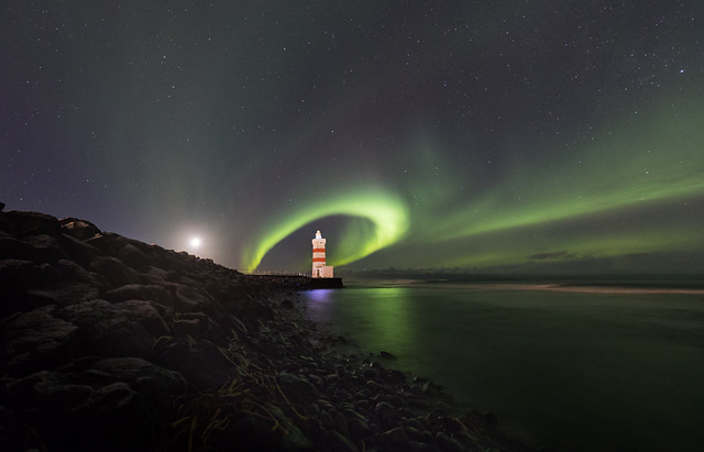The old lighthouse in Garður surrounded with northern lights