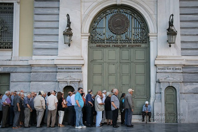 Greek Crisis Pensioners queue outside banks for ration payout
