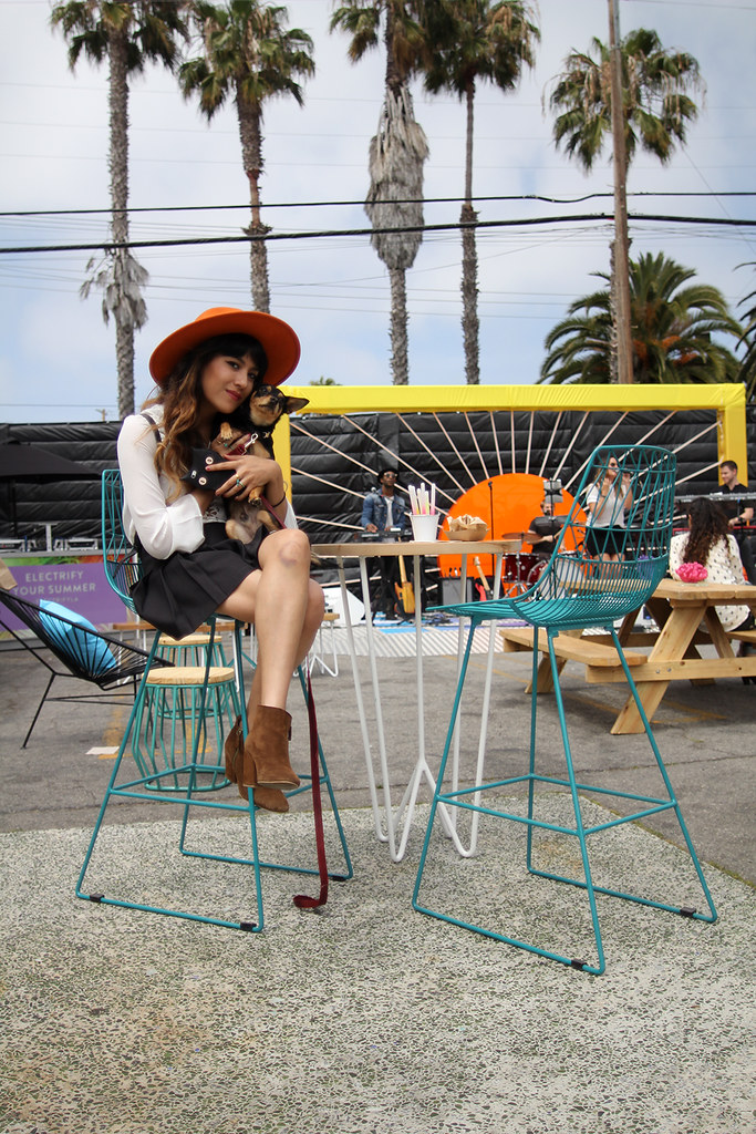 Rust orange wide brim hat, Nasty Gal lace up top, American Apparel pleated tennis skirt, brown suede Zara boots, Sunglass Hut ElectrifyLA event, vintage Coach backpack