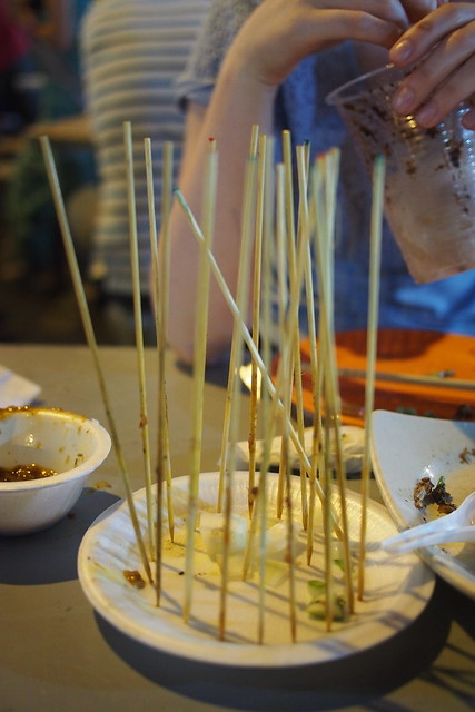 Tour of Singapore: satay stick trophies next to Lau Pat Sat