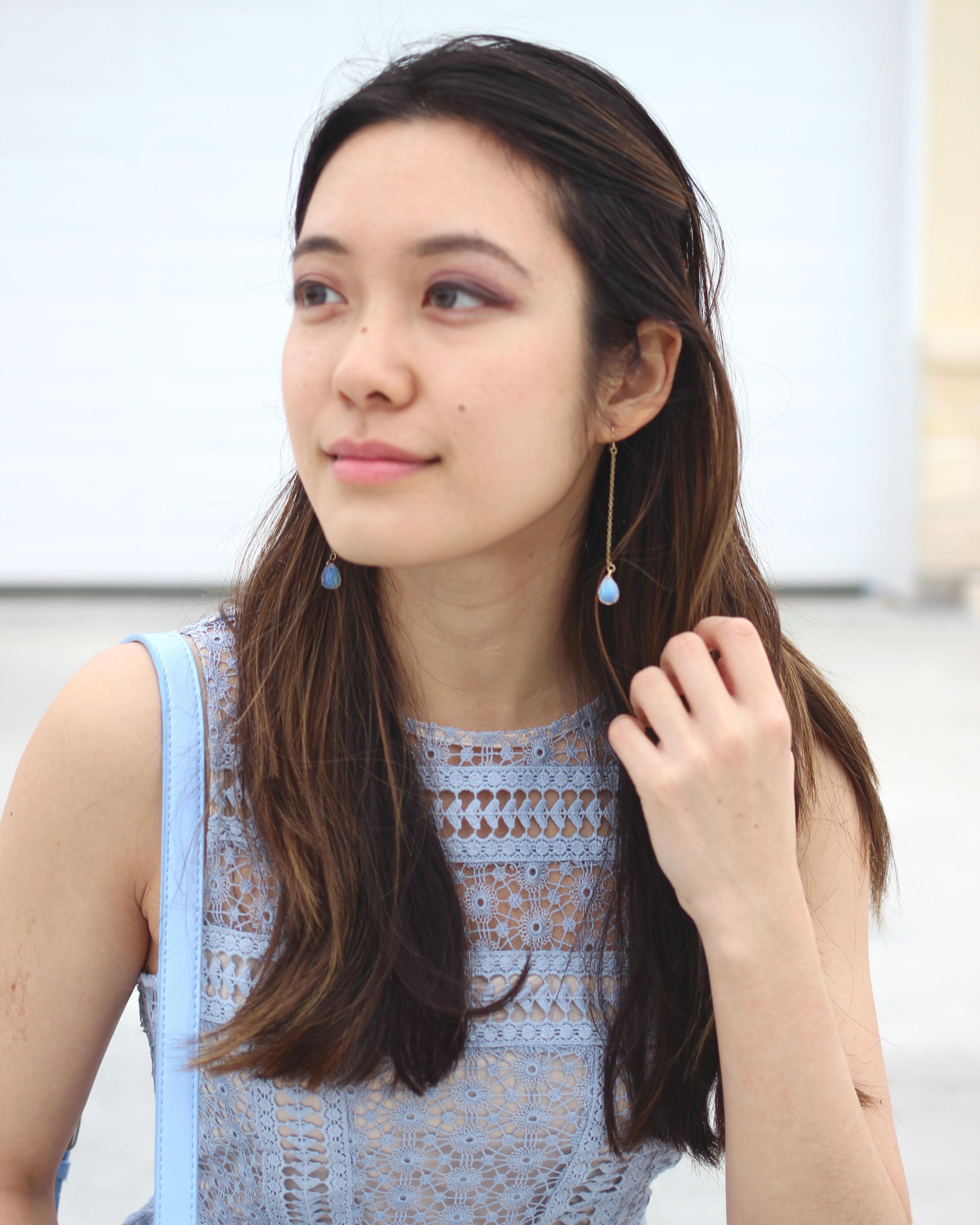 Teardrop earrings and blue lace panel dress