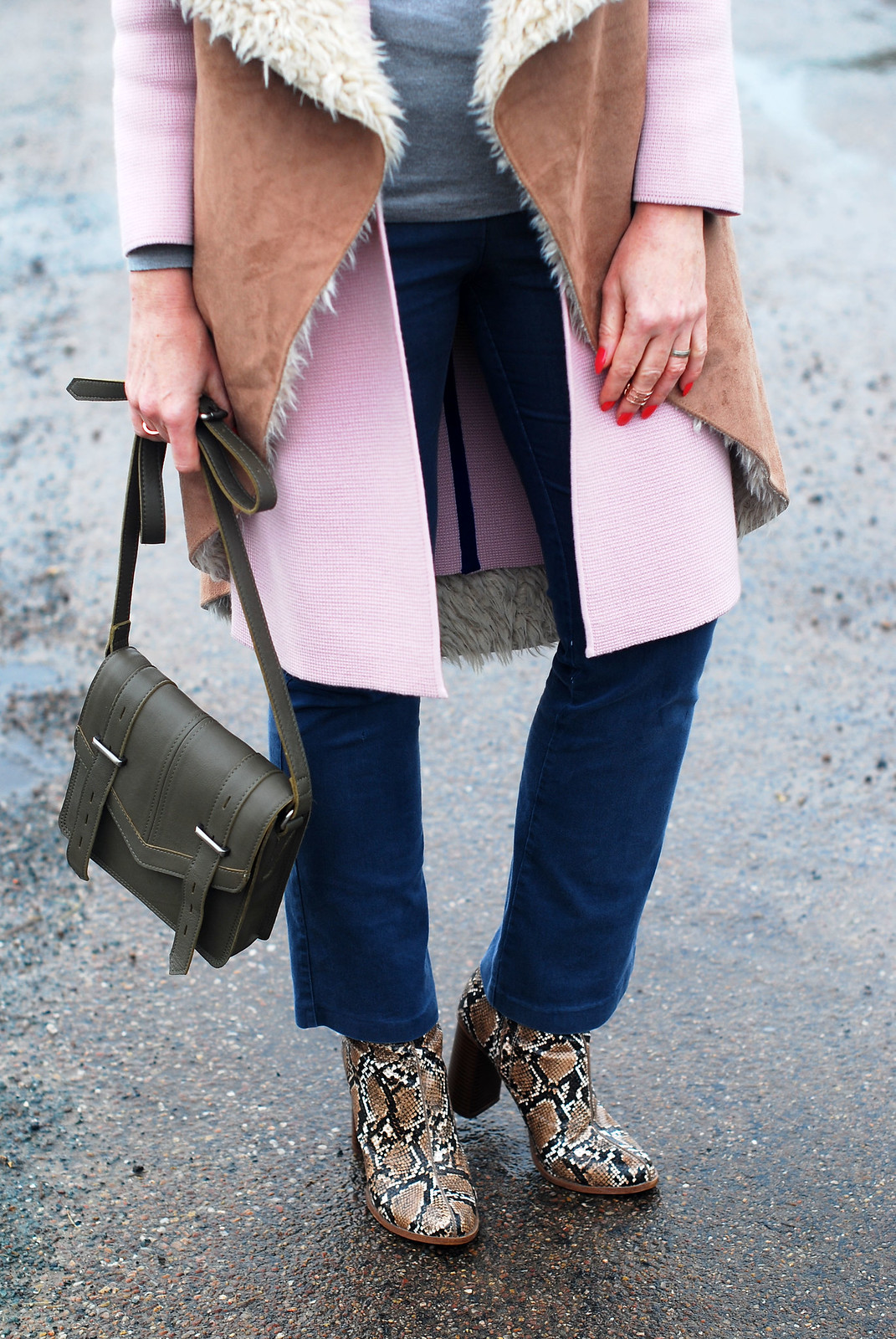 Layered winter outfit \ oversized faux shearling gilet \ pink coatigan \ grey roll neck \ flared denim trousers \ snakeskin ankle boots | Not Dressed As Lamb, over 40 style