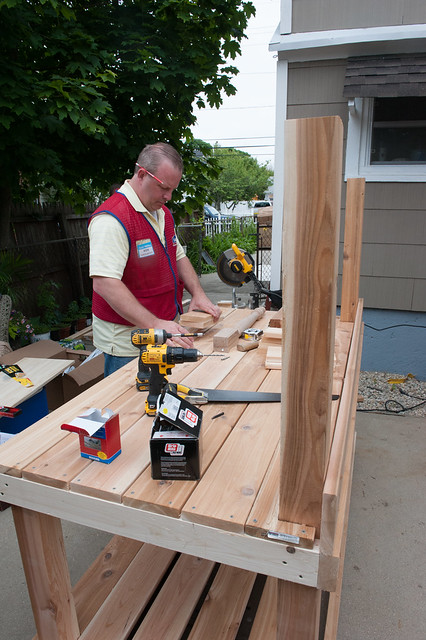 Lowes volunteer helping to build our outdoor potting bench
