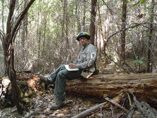 Frank Lake, research ecologist with the U.S. Forest Service's Pacific Southwest Station, jots down some field notes after visiting a forest study plot in northern California. (Photo Credit: Kenny Sauve, Western Klamath Restoration Partnership).