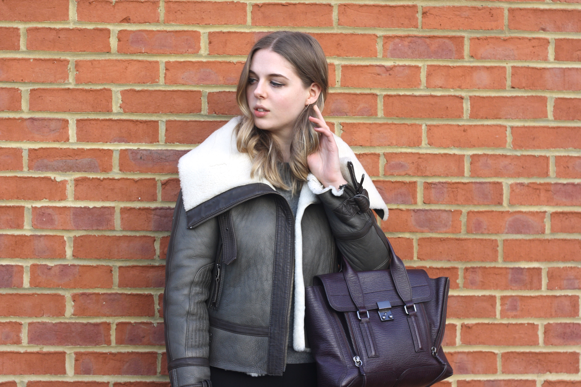 HM grey cashmere jumper, Topshop shearling jacket and 3.1 Phillip Lim medium Pashli