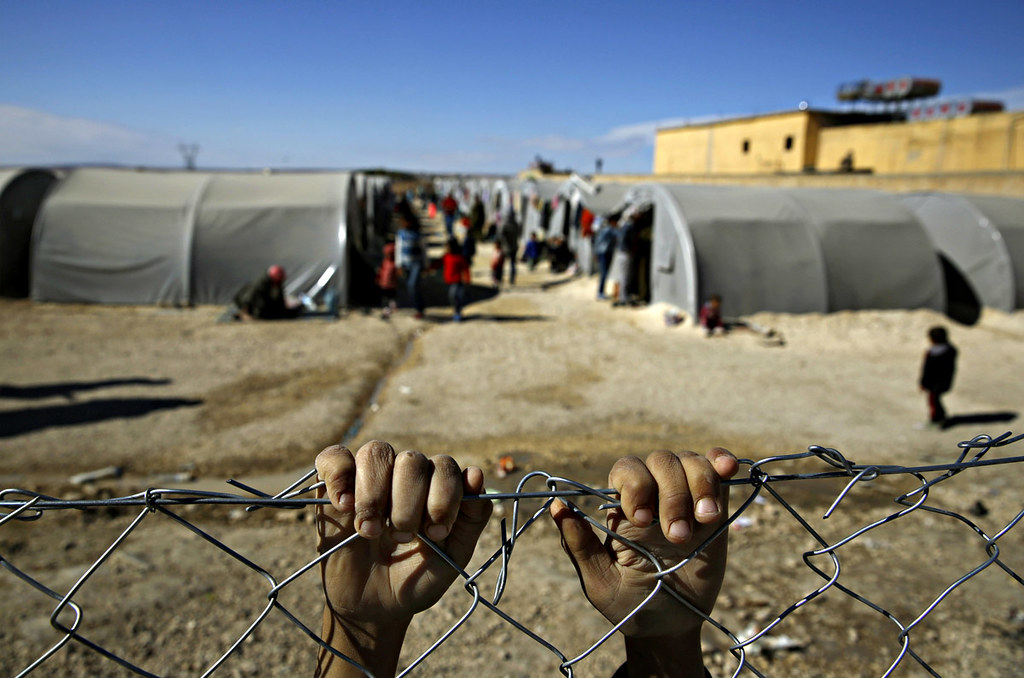 Un jove de Kobane (Síria) refugiat a la frontera turca. YANNIS BEHRAKIS/ REUTERS