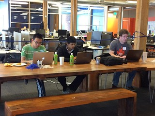Socializing and Hackathoners perfecting their app! | by TC Events