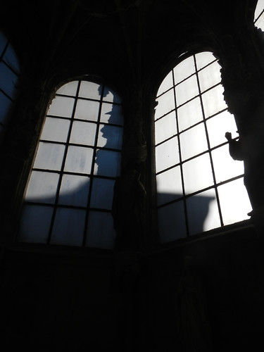 Shadow of the outside steeple falls over the window inside Dieppe Cathedral in France