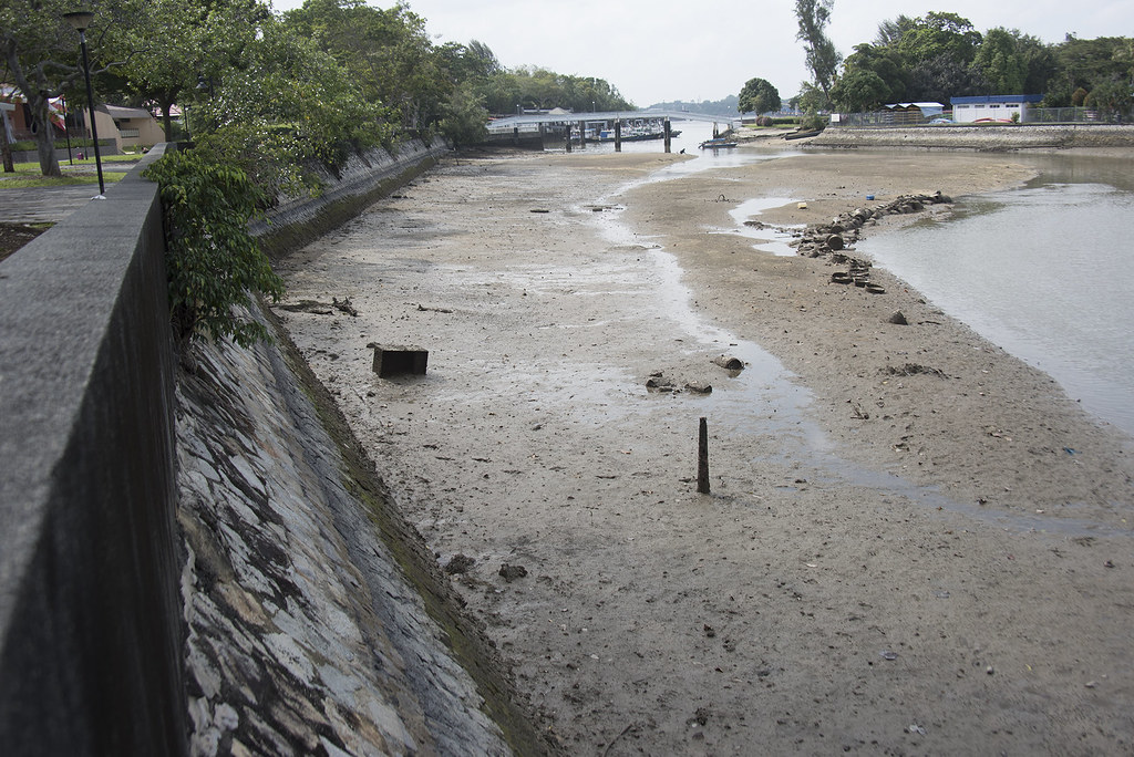 Oil stains on Changi Creek seawalls
