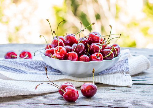 fresh red cherry in a plate,healthy snack, summer, selective focus