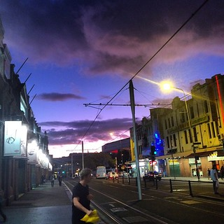 Man looks over his shoulder just as #UFO drops in to abduct him. Nice #clouds & sky over #Chinatown, #Sydney at #sunset too #scifi
