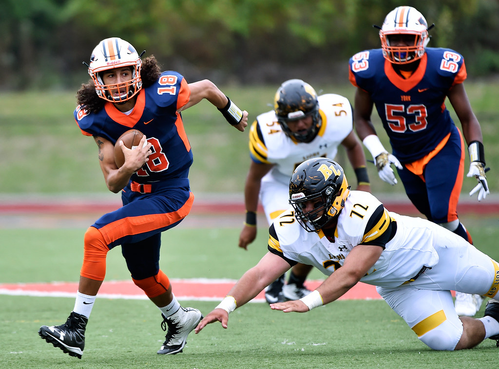 © 2016 by The York Daily Record/Sunday News. William Penn quarterback Tallian Lehr carries the ball past Red Lion's Nick Argento in the first half of a YAIAA football game Saturday, Sept. 24, 2016, at Small Field in York.
