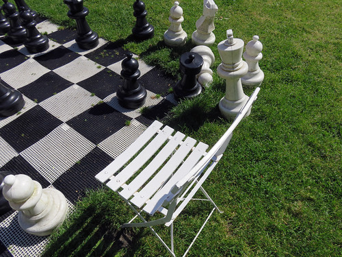 Chess game set up on the grass in the Jumieges Abbey Ruins in France