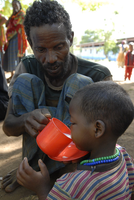 Ibro Bekeri Yusef feeds therapeutic milk F75 to his severely malnourished five-year-old daughter Khesna