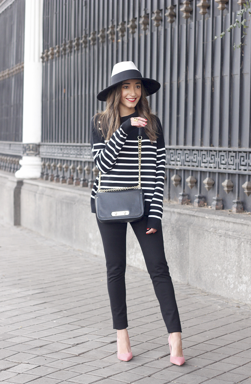 striped sweater maje pink heels black trousers coach bag uterqüe hat accessories style fashion03