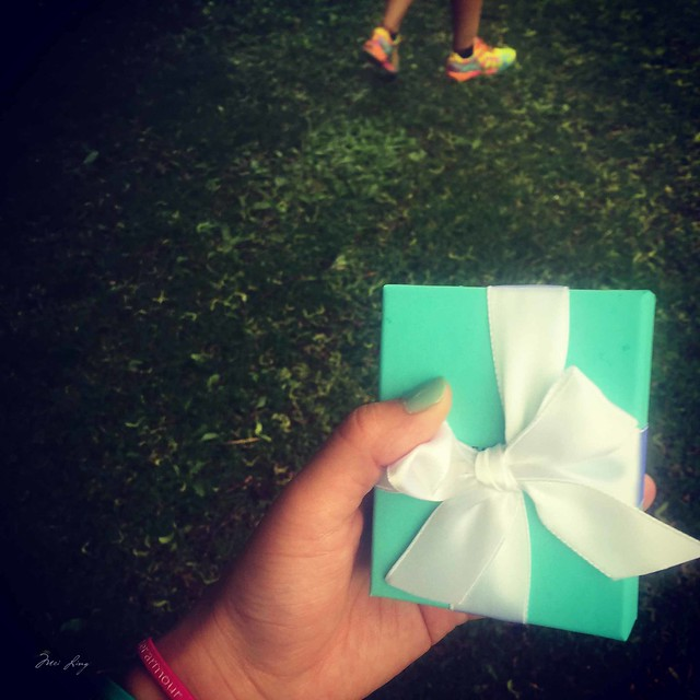 Holding the Tiffany box with the finisher's necklace inside.