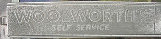 "Woolworth's ""self service"" push bar on the front door 