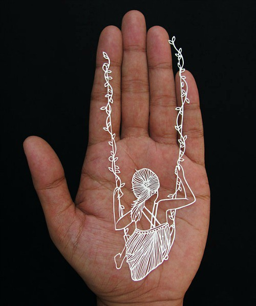Papercut of a girl in a swing by Parth Kothekar