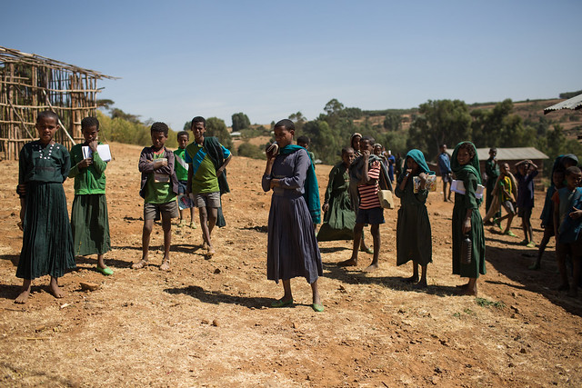 Haimanot Gashu (center), 12, stands outside the Goha Primary School in Goha Kebele, Dera Woreda, Amhara Region, Ethiopia