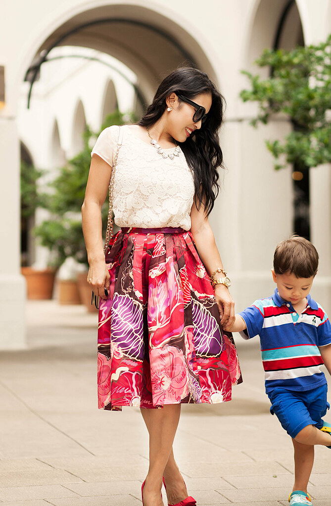 cute & little blog | petite fashion | lace top, red floral pleated midi skirt, red bow heels | outfit | mommy and me