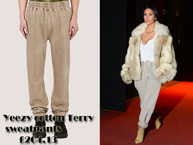 Kim-Kardashian-in-Yeezy-cotton-Terry-sweatpants,white fur coat , jogger pants, white plunging tee-shirt, fur jacket, gold necklaces, yellow lace up heeled boots