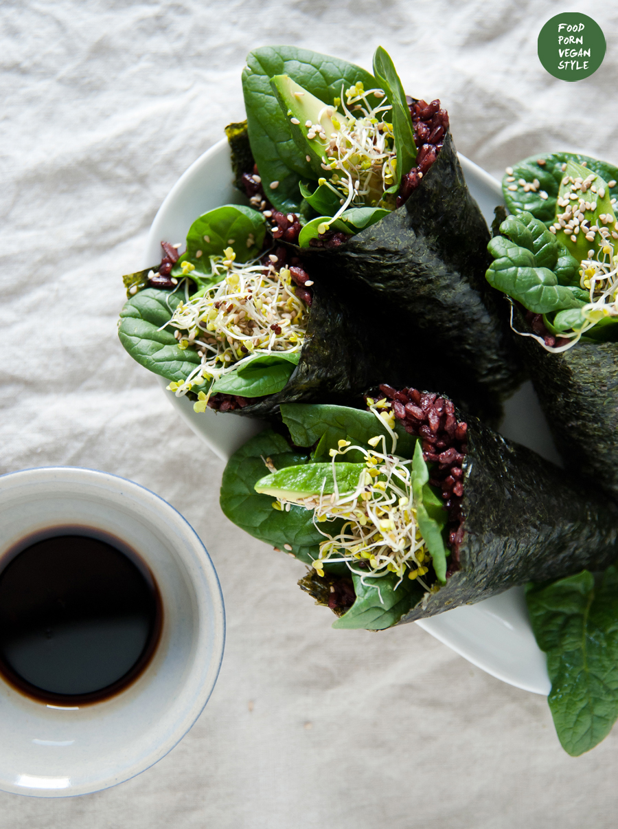 Vegan sushi rolls with black rice, spinach and avocado