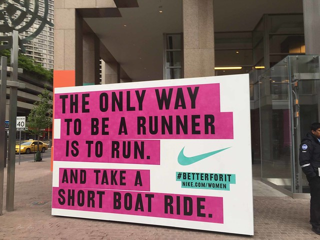 "Nike race sign that says ""The only way to be a runner is to run. And take a short boat ride."""