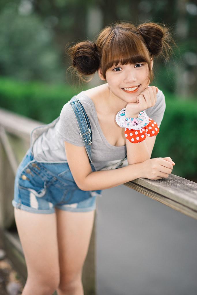 Asian teens in overalls