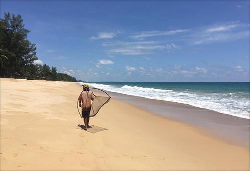 Fisherman at Thai Mueang beach