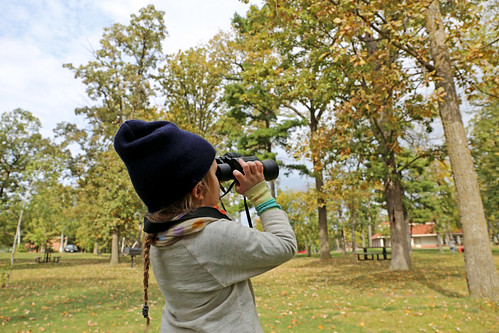 #FSSQUAD – one of the students gazes out on Bemidji Park in search of a Bald Eagle that had just flown overhead (Photo Credit: Julia Schweitzer, Wilderness Inquiry).