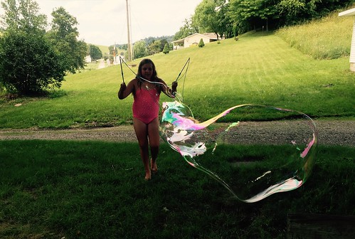 Haylee makes a giant bubble