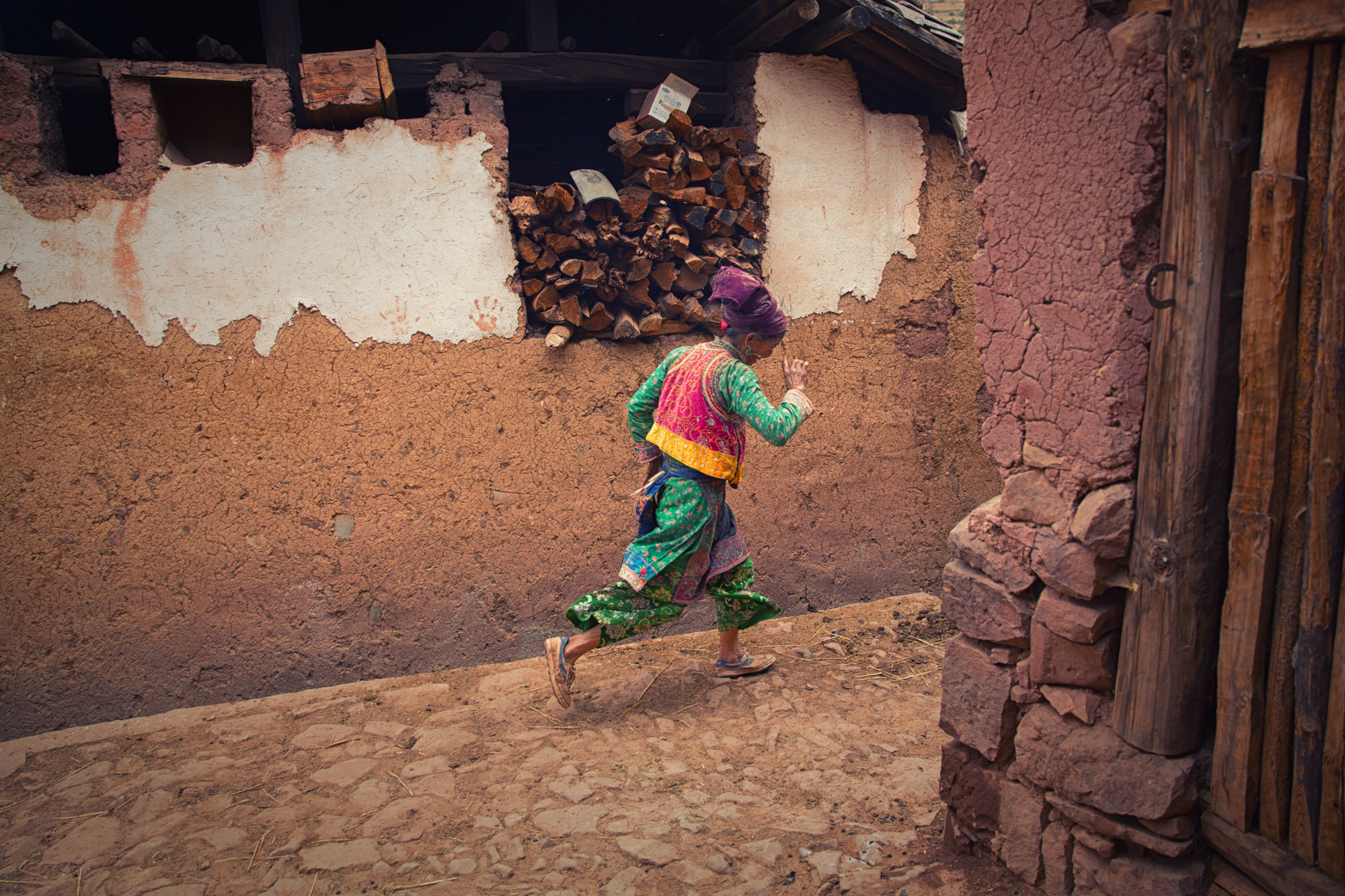 she bashfully ran in a swoosh of color~ Yi Minority~ Yunnan