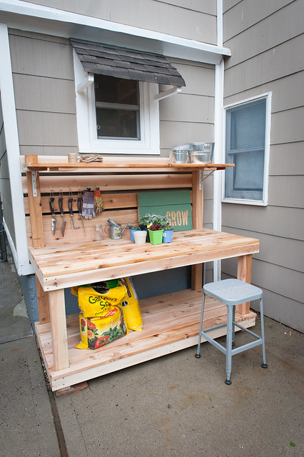 Outdoor living room Potting bench from a 45 degree angle with a top shelf for holding pots and a bottom shelf for holding dirt