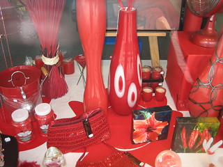 Red glass in shop window, New Zealand | by leahbrooks