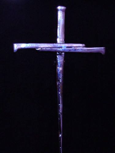 cross of nails adorning an end of the choir stalls in st