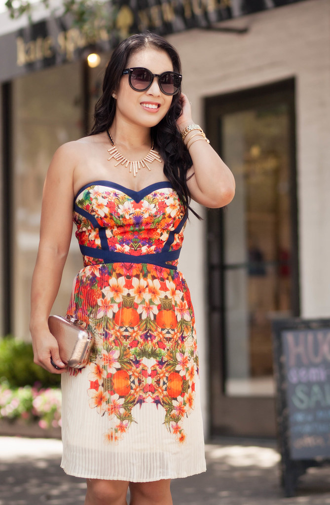 cute & little blog | strapless floral pleated dress, red bow pumps | summer outfit