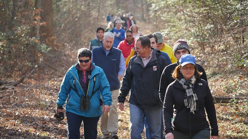 Photo of Secretary Mark Belton talking with hikers