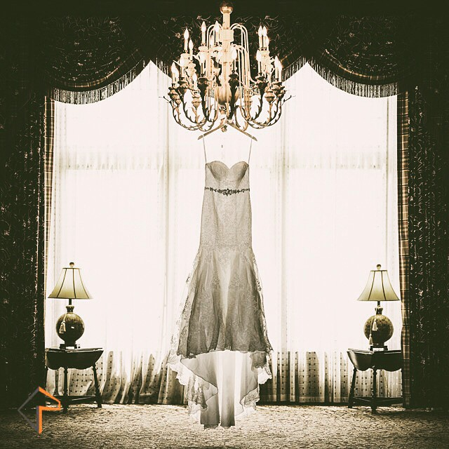 Betsys beautiful wedding dress hanging from a chandelier flickr image betsys beautiful wedding dress hanging from a chandelier in the sylvania country club image mozeypictures Gallery