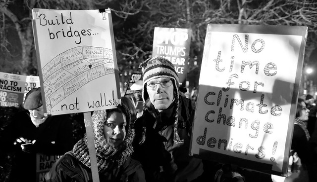 Build Bridges, Not Walls - No Time to Deny Climate Change - important messages from two protesters outside the US Embassy in London