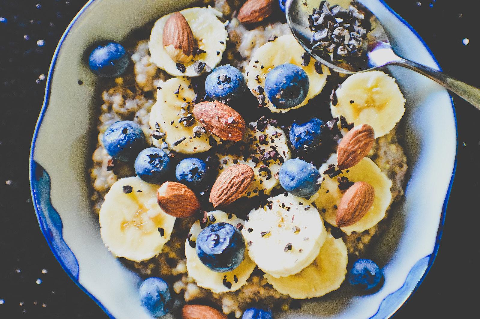 Creamy Banana Buckwheat Porridge with Blueberries, Almonds & Cacao Nibs