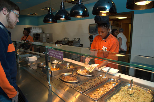 A student orders a meal of fresh food from the aquaponics initiative.