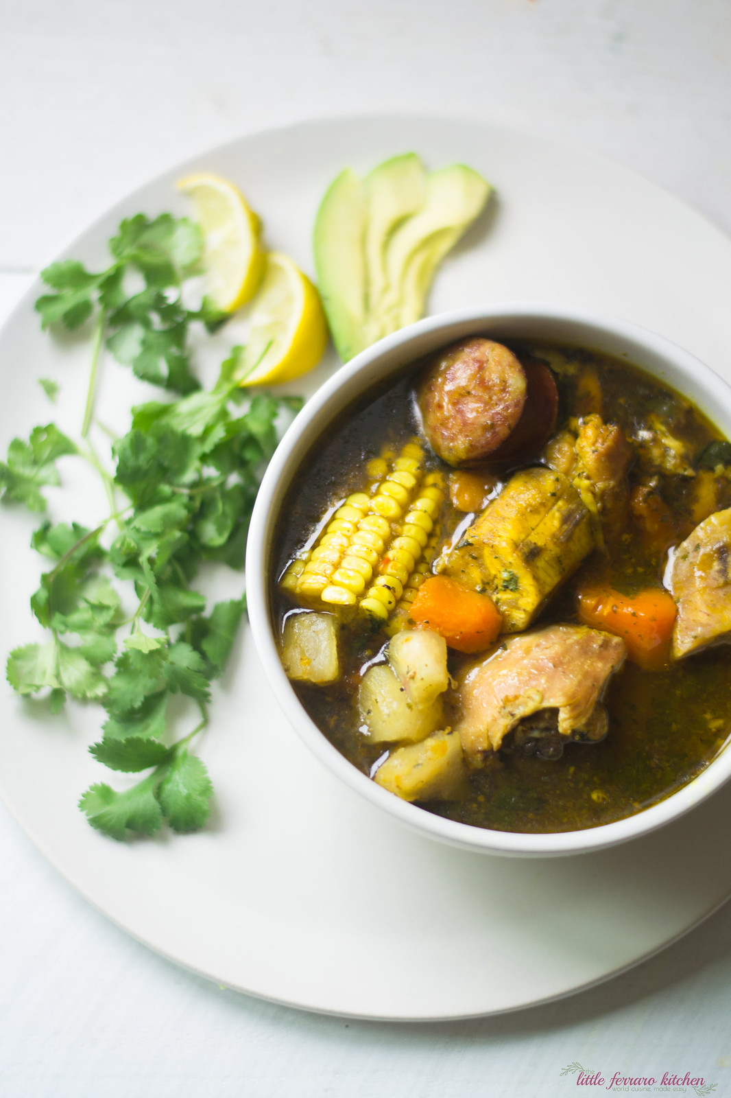 Dominican stew is full of layers of flavor with sazon, adobo and hearty vegetables of yucca and corn.
